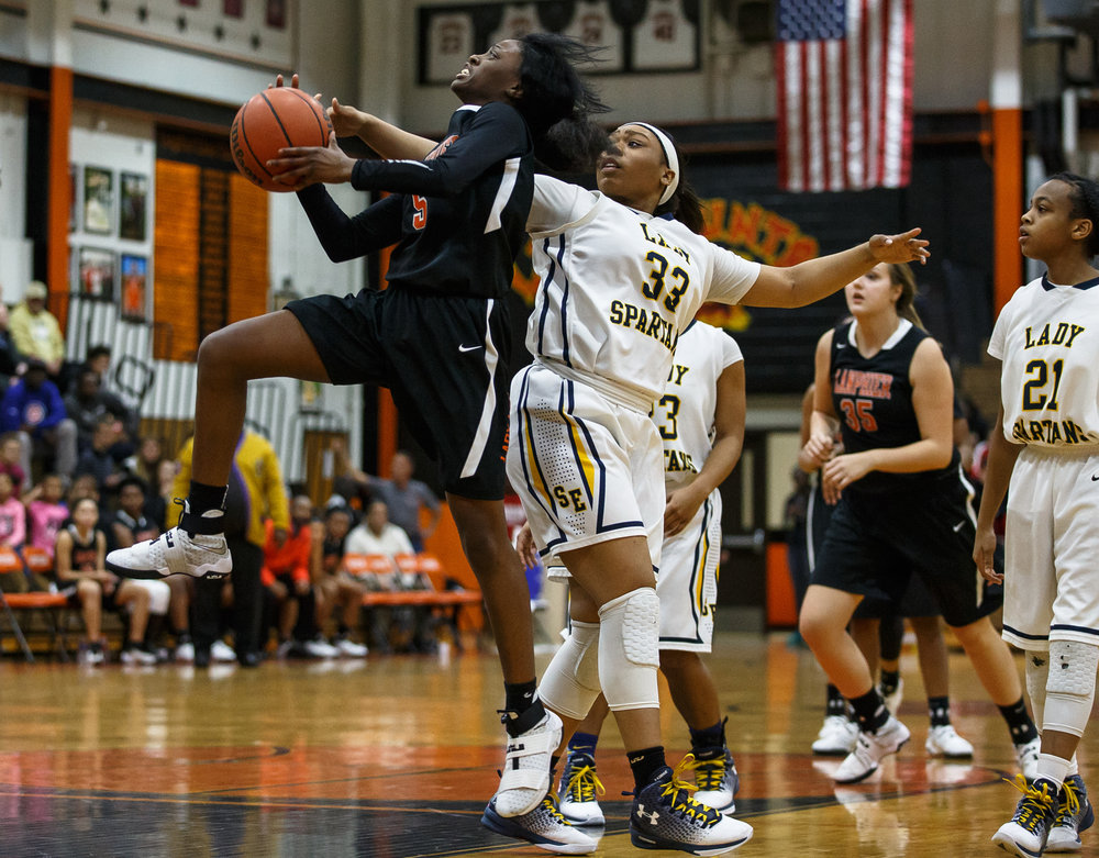 Lanphier's Jeniya Griffin (5) draws the foul as she goes up for a shot against Southeast's Kelsey Alexander (33) in the second quarter during the third place game of the Girls City Basketball Tournament at Lanphier High School, Thursday, Jan. 26, 2017, in Springfield, Ill. Justin L. Fowler/The State Journal-Register