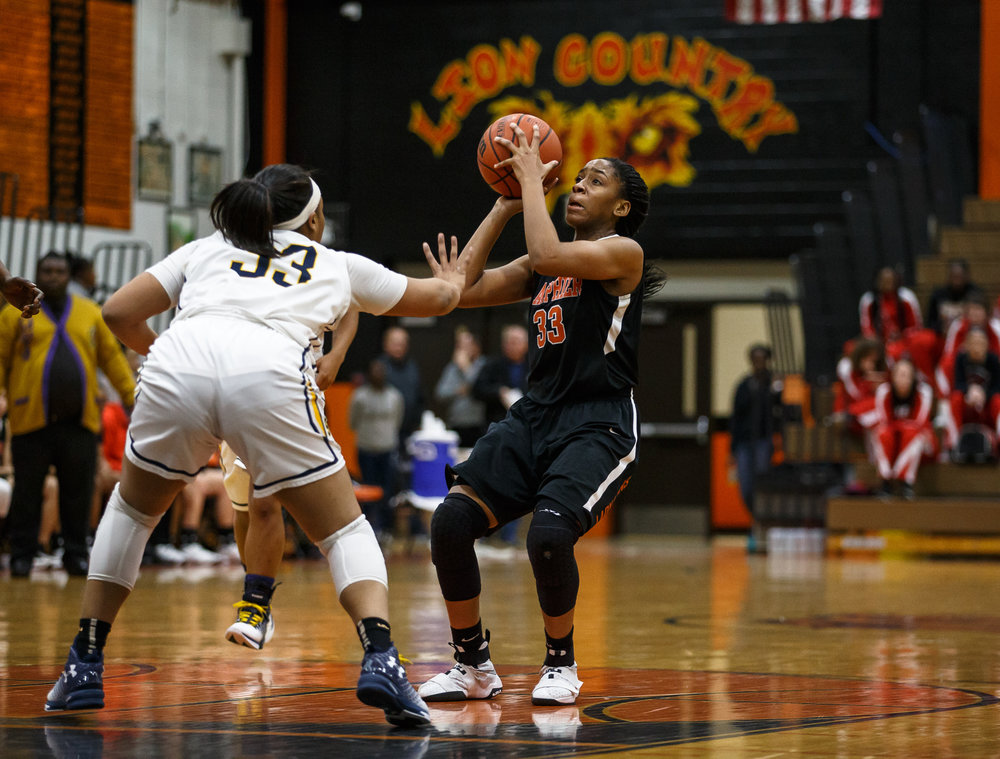 Lanphier's Jaala Smylie (33) pulls up for a jumper against Southeast's Kelsey Alexander (33) in the second quarter during the third place game of the Girls City Basketball Tournament at Lanphier High School, Thursday, Jan. 26, 2017, in Springfield, Ill. Justin L. Fowler/The State Journal-Register