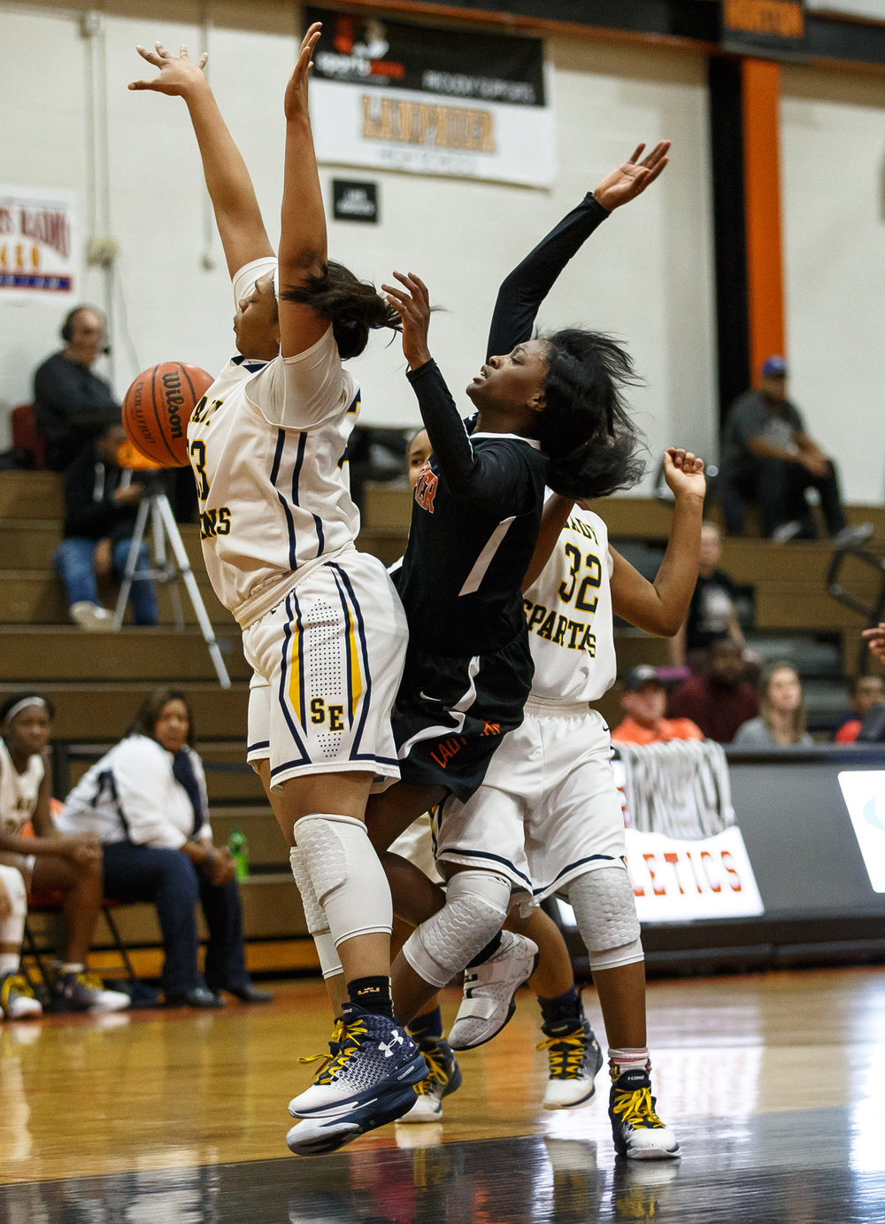 Lanphier's Jeniya Griffin (5) draws the foul as she drives into the basket against Southeast's Kelsey Alexander (33) and Southeast's Jade King (32) in the second quarter during the third place game of the Girls City Basketball Tournament at Lanphier High School, Thursday, Jan. 26, 2017, in Springfield, Ill. Justin L. Fowler/The State Journal-Register