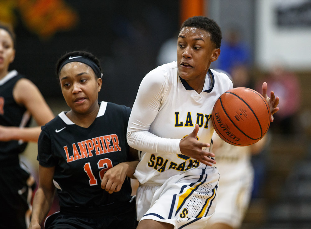 Southeast's Arryl Barbee (3) drives to the basket against Lanphier's Destiny Allen (12) in the third quarter during the third place game of the Girls City Basketball Tournament at Lanphier High School, Thursday, Jan. 26, 2017, in Springfield, Ill. Justin L. Fowler/The State Journal-Register