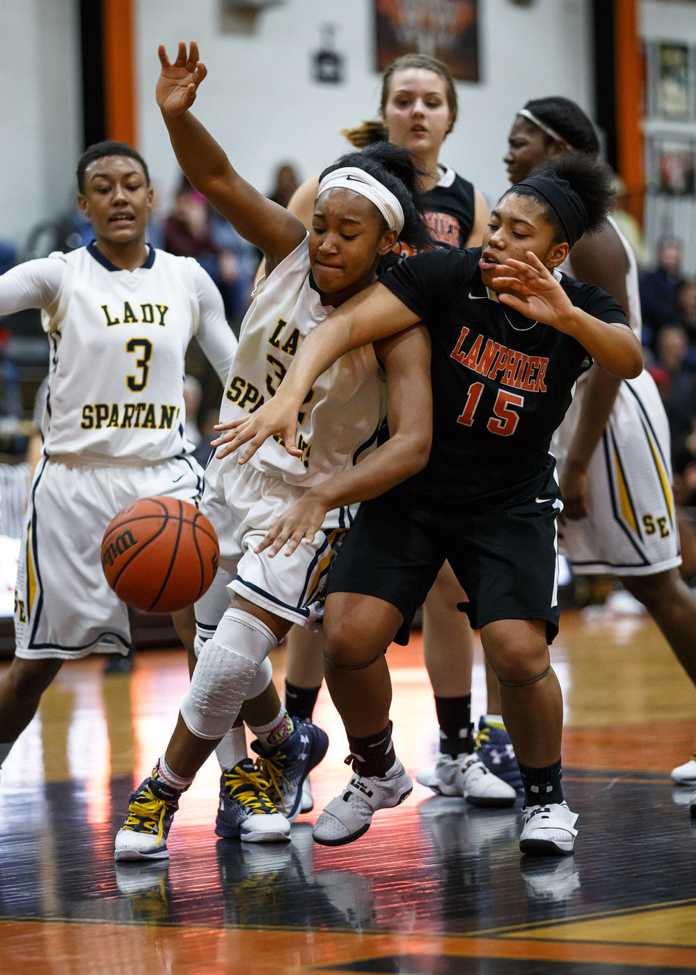 Southeast's Jade King (32) and Lanphier's Faith Price (15) battle for possession of the ball underneath the basket in the fourth quarter during the third place game of the Girls City Basketball Tournament at Lanphier High School, Thursday, Jan. 26, 2017, in Springfield, Ill. Justin L. Fowler/The State Journal-Register