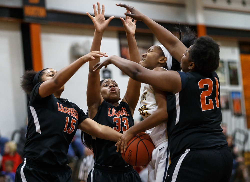Southeast's Jade King (32) tries to go back up for a shot against a trio of Lanphier defenders in the fourth quarter during the third place game of the Girls City Basketball Tournament at Lanphier High School, Thursday, Jan. 26, 2017, in Springfield, Ill. Justin L. Fowler/The State Journal-Register