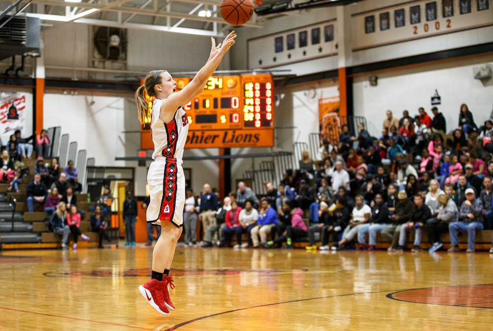 Springfield's Ashley Robinson (3) fires off a wide open three against Sacred Heart-Griffin in the first quarter during the championship game of the Girls City Basketball Tournament at Lanphier High School, Thursday, Jan. 26, 2017, in Springfield, Ill. Justin L. Fowler/The State Journal-Register