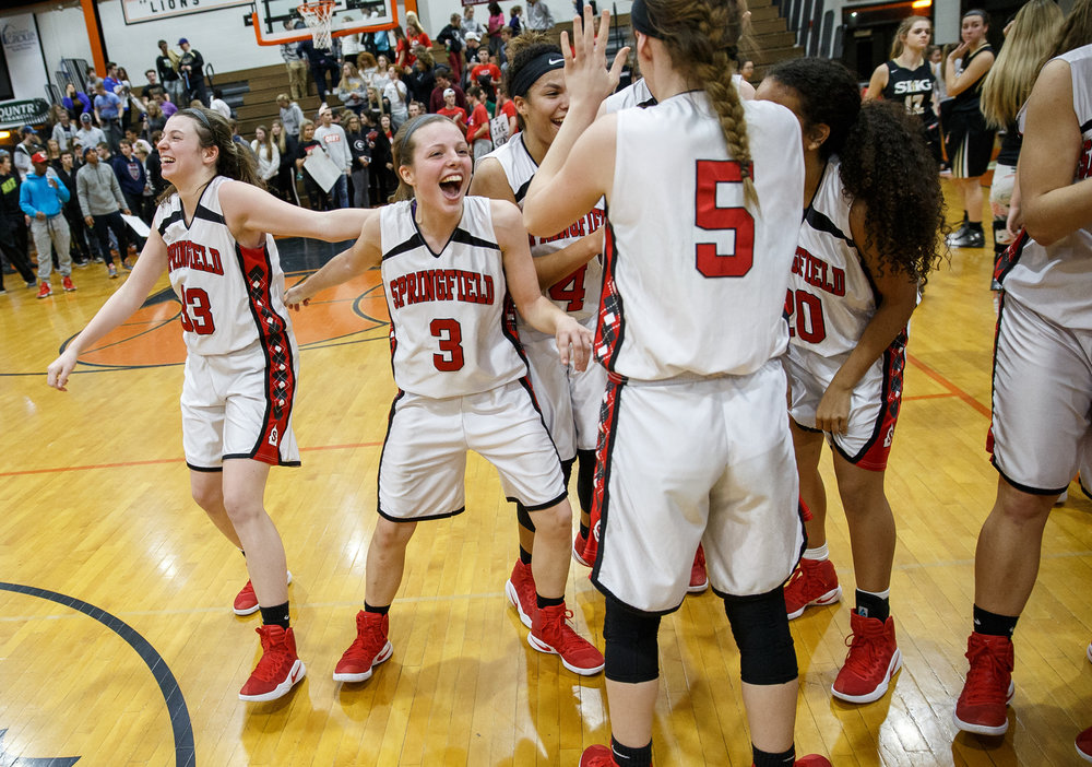 Springfield's Ashley Robinson (3) and the Senators celebrate their 61-44 victory over Sacred Heart-Griffin in the championship game of the Girls City Basketball Tournament at Lanphier High School, Thursday, Jan. 26, 2017, in Springfield, Ill. Justin L. Fowler/The State Journal-Register