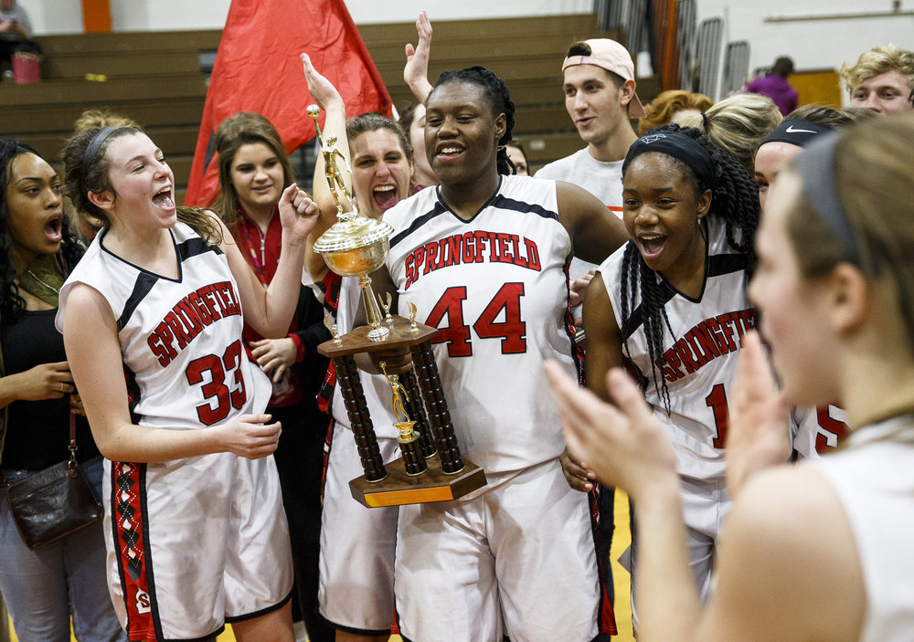 Springfield's Montshianna Pulliam (44) and the Senators celebrate with the championship trophy after defeating Sacred Heart-Griffin 61-44 in the Girls City Basketball Tournament at Lanphier High School, Thursday, Jan. 26, 2017, in Springfield, Ill. Justin L. Fowler/The State Journal-Register