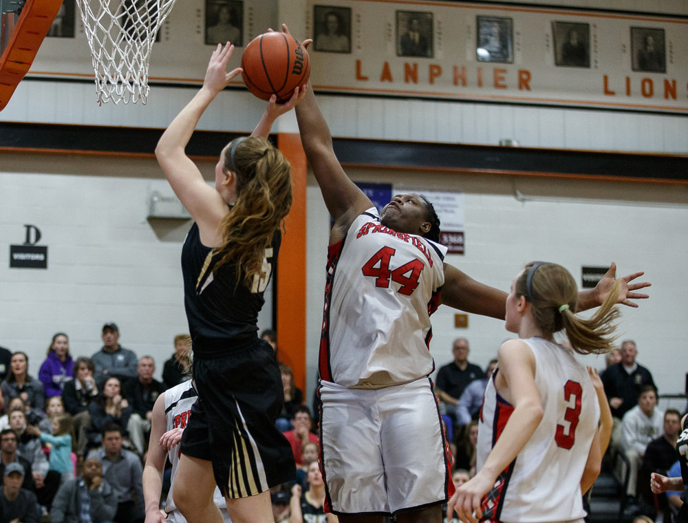 Springfield's Montshianna Pulliam (44) blocks a shot from Sacred Heart-Griffin's Abbie Antonacci (15) in the fourth quarter during the championship game of the Girls City Basketball Tournament at Lanphier High School, Thursday, Jan. 26, 2017, in Springfield, Ill. Justin L. Fowler/The State Journal-Register
