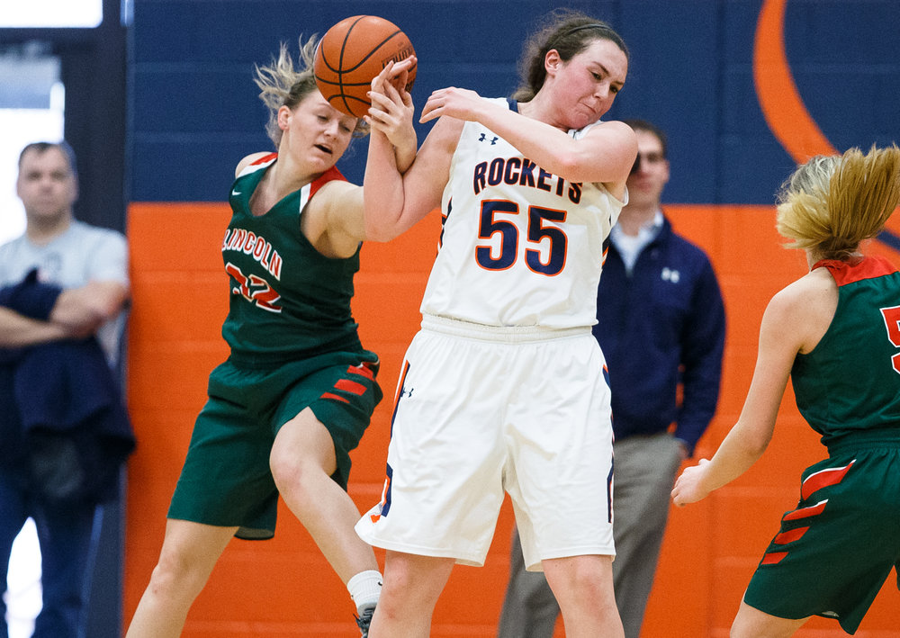 Lincoln's Lauren Block (32) knocks a pass out of the hands of Rochester's Angela Perry (55) in the second quarter during the CS8 Non-City Tournament at the Rochester Athletic Complex, Saturday, Jan. 28, 2017, in Rochester, Ill. Justin L. Fowler/The State Journal-Register