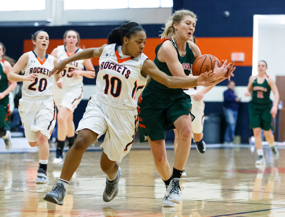 Rochester's Havilyn Dulin (10) forces a travel from Lincoln's Kaelyn Froebe (5) as she drives to the basket in the second quarter during the CS8 Non-City Tournament at the Rochester Athletic Complex, Saturday, Jan. 28, 2017, in Rochester, Ill. Justin L. Fowler/The State Journal-Register