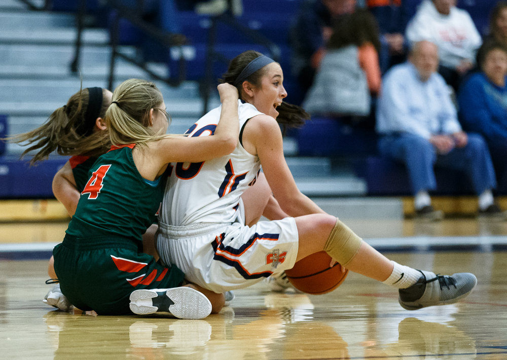 Rochester's Aubrey Magro (20) tries to pass a loose ball recovered off the floor against Lincoln's Haley Hicks (4) in the third quarter during the CS8 Non-City Tournament at the Rochester Athletic Complex, Saturday, Jan. 28, 2017, in Rochester, Ill. Justin L. Fowler/The State Journal-Register