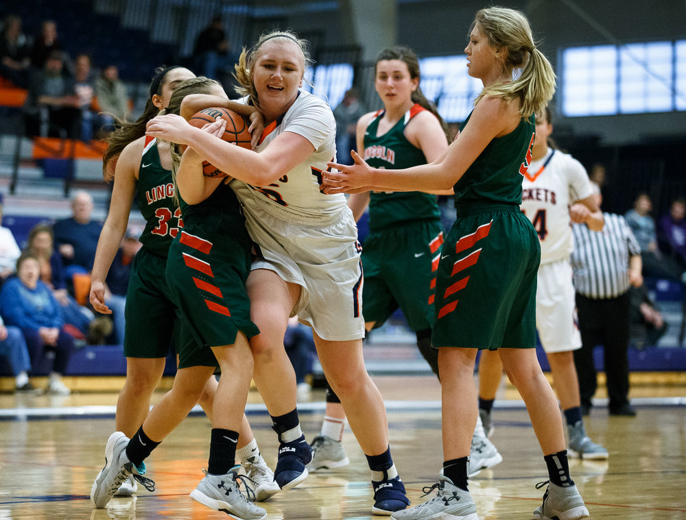 A jump ball is called as Rochester's Madison Faulkner (35) gets tangled up with Lincoln's Haley Hicks (4) in the third quarter during the CS8 Non-City Tournament at the Rochester Athletic Complex, Saturday, Jan. 28, 2017, in Rochester, Ill. Justin L. Fowler/The State Journal-Register
