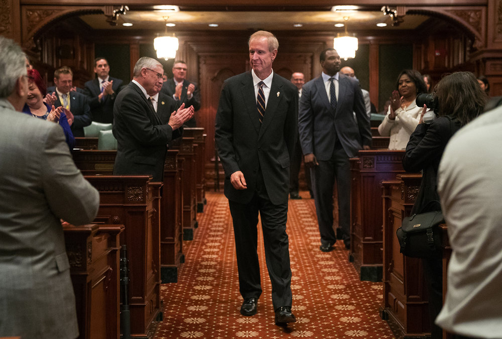 Illinois Gov. Bruce Rauner enters the Illinois House chamber to deliver his State of the State address Wednesday, Jan. 25, 2017. Ted Schurter/The State Journal-Register