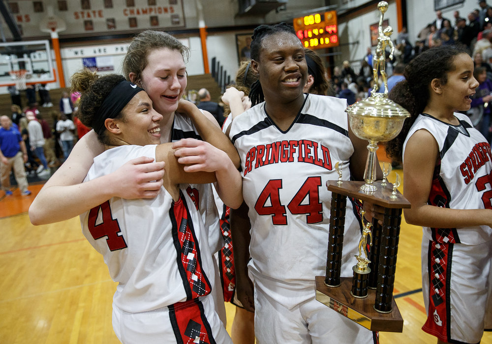 Springfield's Raina Gully (4) hugs Abby Ratsch (40) as they celebrate the Senators 61-44 victory over Sacred Heart-Griffin in the championship game of the Girls City Basketball Tournament at Lanphier High School, Thursday, Jan. 26, 2017, in Springfield, Ill. Justin L. Fowler/The State Journal-Register