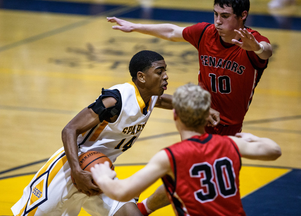 Southeast's Trevyon Williams (14) drives towards the basket against Springfield's Trevor Minder (10) and Springfield's Will Reiser (30) in the second quarter at Herb Scheffler Gymnasium, Tuesday, Feb. 7, 2017, in Springfield, Ill. [Justin L. Fowler/The State Journal-Register]