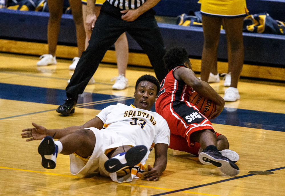 Southeast's Mark Johnson (33) and Springfield's Caleb Small (12) hit the floor diving for a loose ball in the second quarter at Herb Scheffler Gymnasium, Tuesday, Feb. 7, 2017, in Springfield, Ill. [Justin L. Fowler/The State Journal-Register]