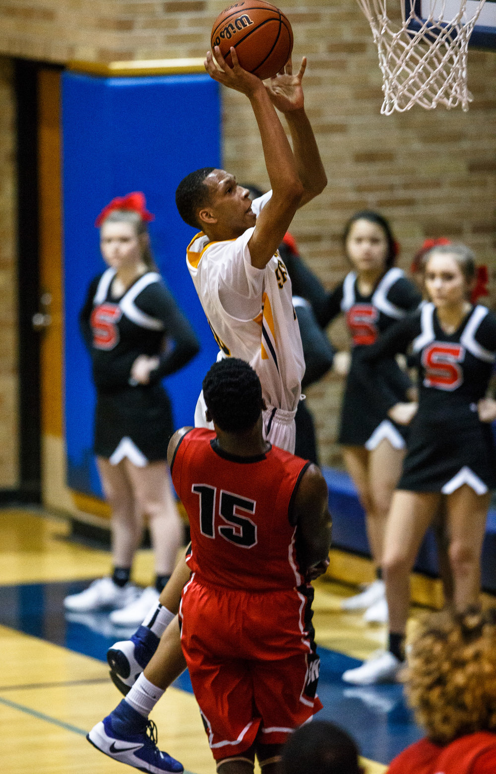 Southeast's Isaiah Walton (10) goes up for a basket against Springfield's Ananise Mackey (15) in the second quarter at Herb Scheffler Gymnasium, Tuesday, Feb. 7, 2017, in Springfield, Ill. [Justin L. Fowler/The State Journal-Register]