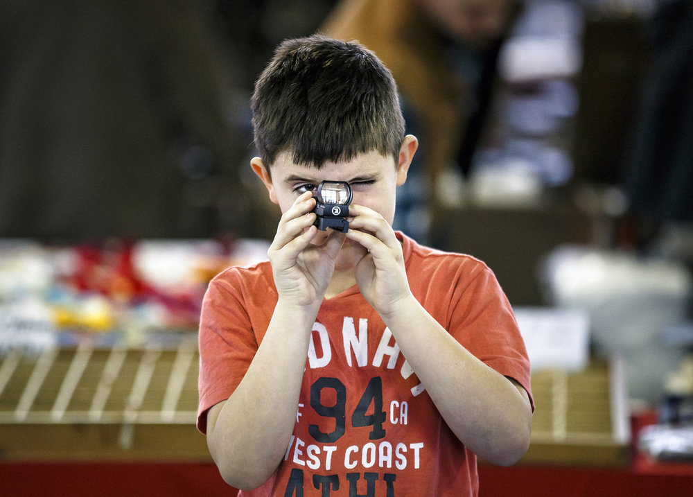 Braden Wikoff, 9, tries out a sight from the Osprey Global booth during the ECA Hunting and Trade Show at the Orr Building, Sunday, Jan. 29, 2017, in Springfield, Ill. Justin L. Fowler/The State Journal-Register