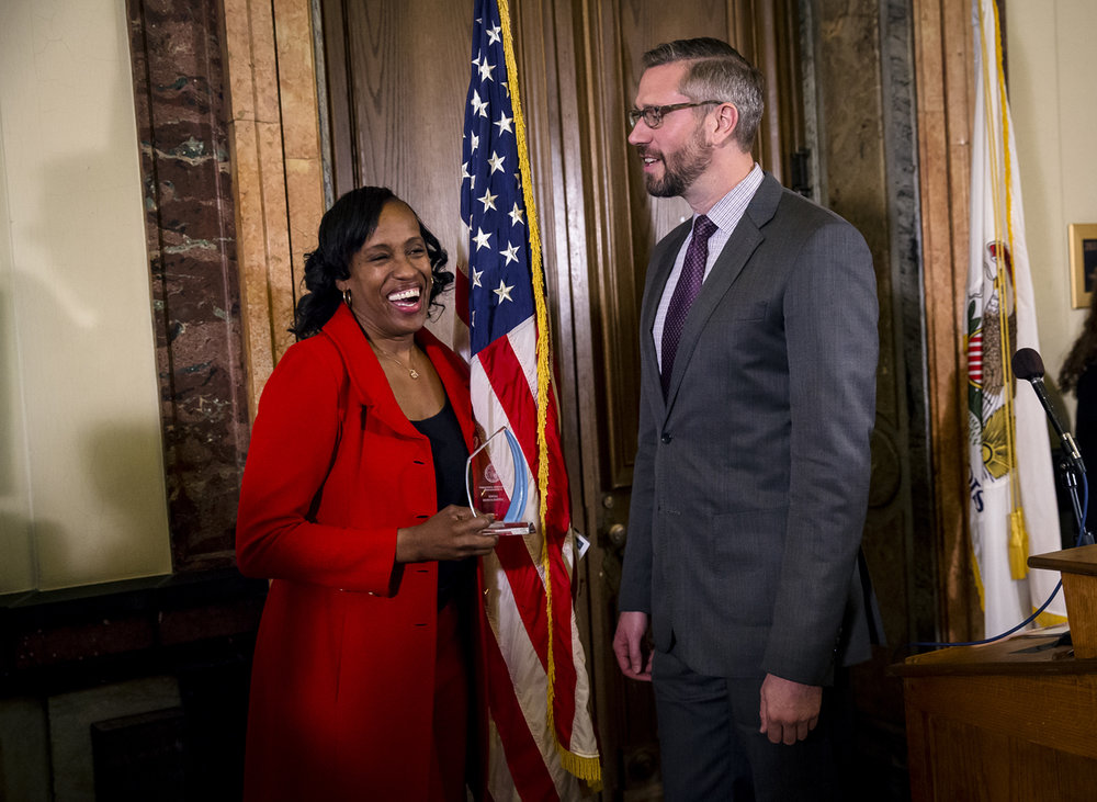 Illinois State Treasurer Michael Frerichs, right, honors Olympic gold medalist Jack Joyner-Kersee, a native of East St. Louis, Ill., with the Outstanding Achievement in Sportsmanship award during a ceremony in honor of Black History Month at the Illinois State Capitol, Wednesday, Feb. 8, 2017, in Springfield, Ill. [Justin L. Fowler/The State Journal-Register]