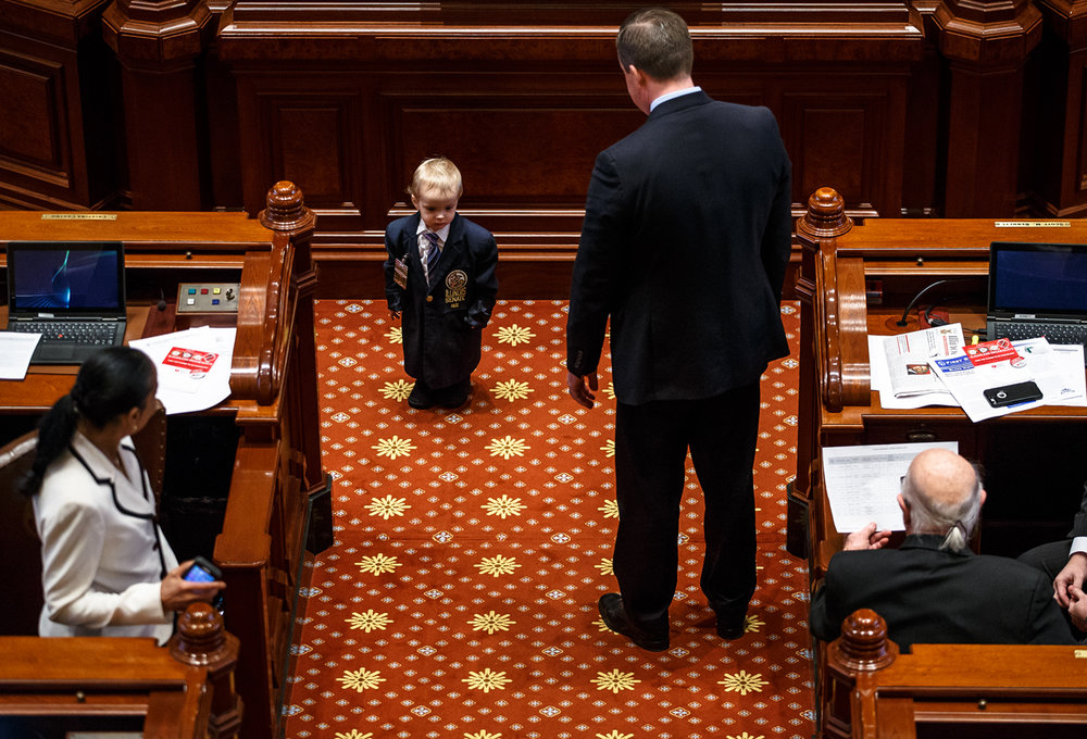 Edward Falcon Burkett, a grandson of Illinois State Sen. William Haine, D-Alton, sizes up Illinois State Sen. Andy Manar, D-Bunker Hill, while exploring the Senate floor at the Illinois State Capitol, Wednesday, Feb. 8, 2017, in Springfield, Ill. [Justin L. Fowler/The State Journal-Register]