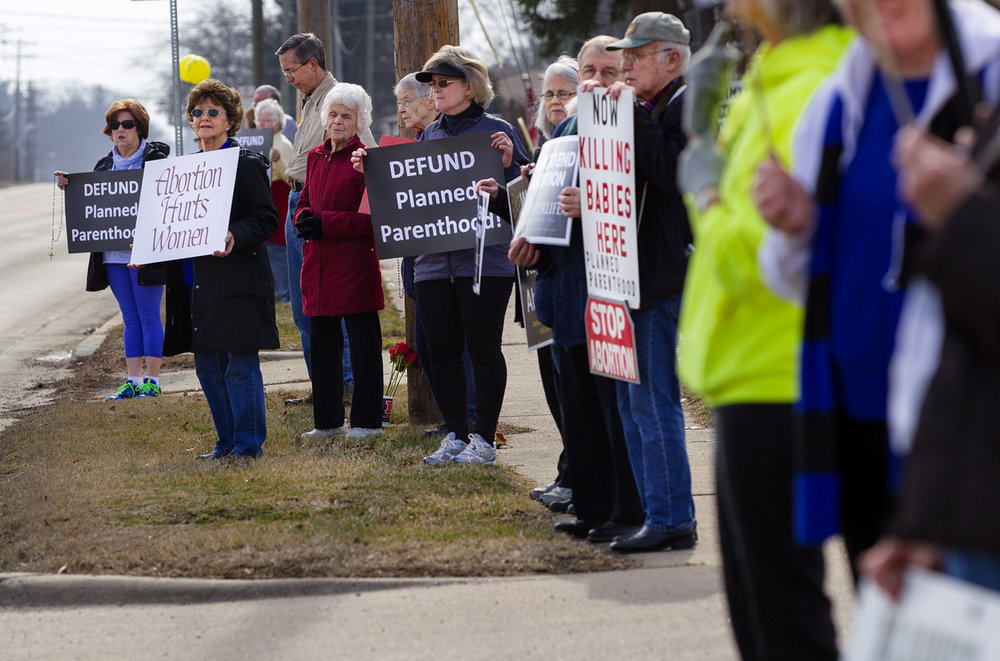 Pat Milnes with the Springfield Right to Life group was joined by about 60 other anti Planned Parenthood protesters outside their Bruns Lane location Saturday, Feb. 11, 2017. [Ted Schurter/The State Journal-Register]