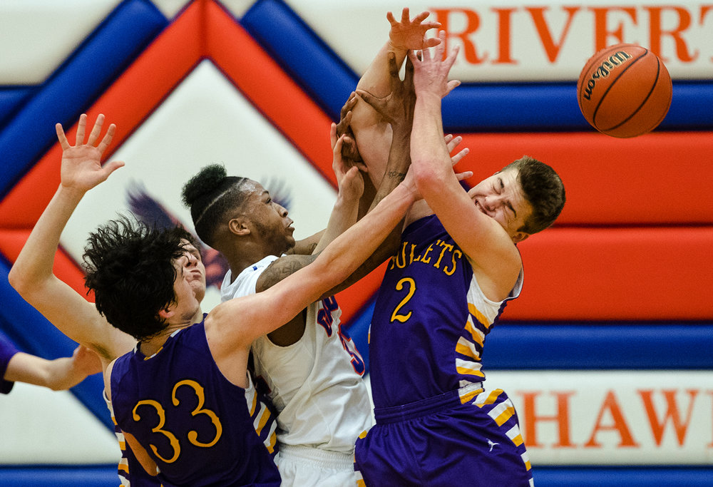Quest Academy's Jaylon Huff tips the ball past Williamsville's Kenton Baskett during the Riverton Subway Shootout at Riverton High School February 11, 2017. [Ted Schurter/The State Journal-Register]