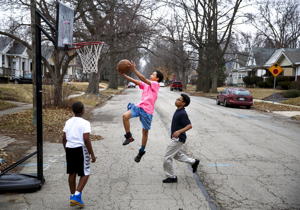 Dehoward Woods, left, Santana Anderson and Jamaria Matthews put in some practice time on their hoop skills Tuesday, Feb . 7, 2017 in the 2300 block of South Tenth Street. The boys are there everyday after school, they said. [Rich Saal/The State Journal-Register]