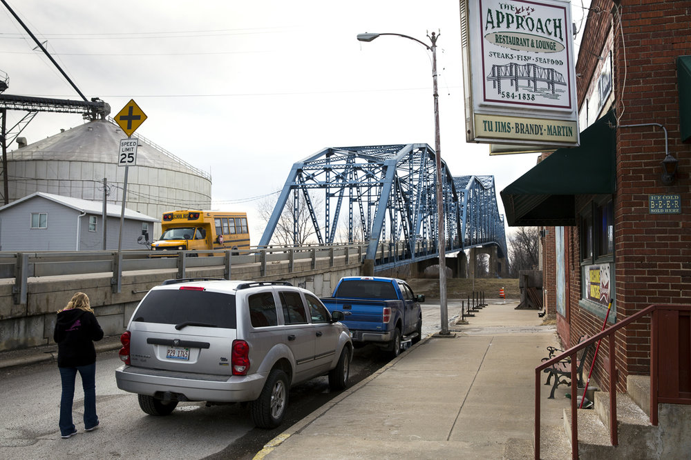 The popular Approach restaurant on Main Street in Meredosia is nestled against the old bridge that carries Illinois 104 over the Illinois River Friday, Feb. 10, 2017. A new bridge that will replace it is under construction one block to the north.[Rich Saal/The State Journal-Register]