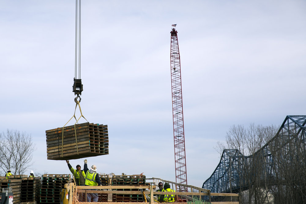 Concrete forms are lifted by crane to the west approach construction of a new $75.1 million bridge that will carry Illinois 104 over the Illinois River at Meredosia Friday, Feb.10, 2017. [Rich Saal/The State Journal-Register]