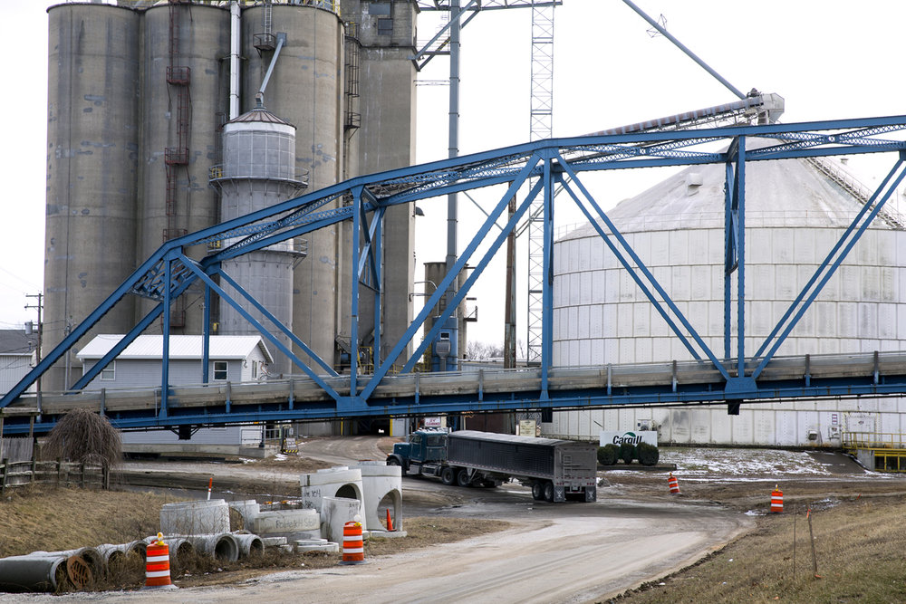 Trucks drive under the Illinois 104 bridge at Meredosia to unload at a Cargill grain facility Friday, Feb. 10, 2017. [Rich Saal/The State Journal-Register]