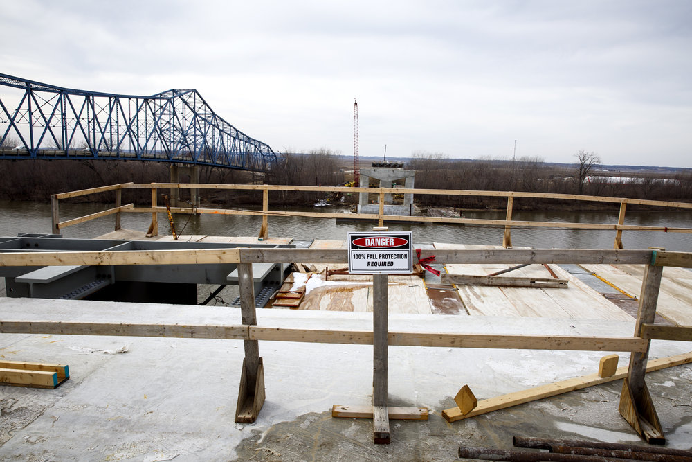 Engineers expect the two spans of the tied-arch bridge, under construction from the east and the west sides simultaneously, will meet high over the river this summer. It will open to traffic in 2018. [Rich Saal/The State Journal-Register]