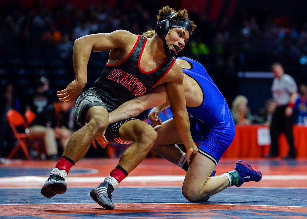 Springfield's Jacquez Stewart escapes from Burlington's Austin Macias in the Class 2A quarterfinal 126 pound match during the 2017 IHSA State Championships at the State Farm Center in Champaign, Ill., Friday, Feb. 17, 2017. Stewart lost. Ted Schurter/The State Journal-Register