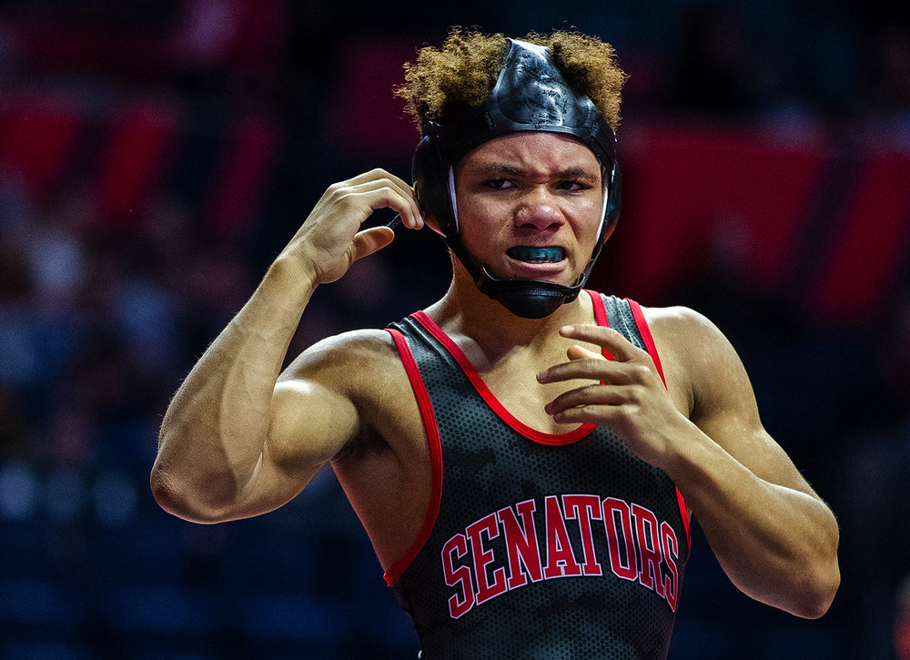 Springfield's Jacquez Stewart reacts after losing a decision to Burlington's Austin Macias in the Class 2A 126 pound quarterfinal match during the 2017 IHSA State Championships at the State Farm Center in Champaign, Ill., Friday, Feb. 17, 2017. Ted Schurter/The State Journal-Register