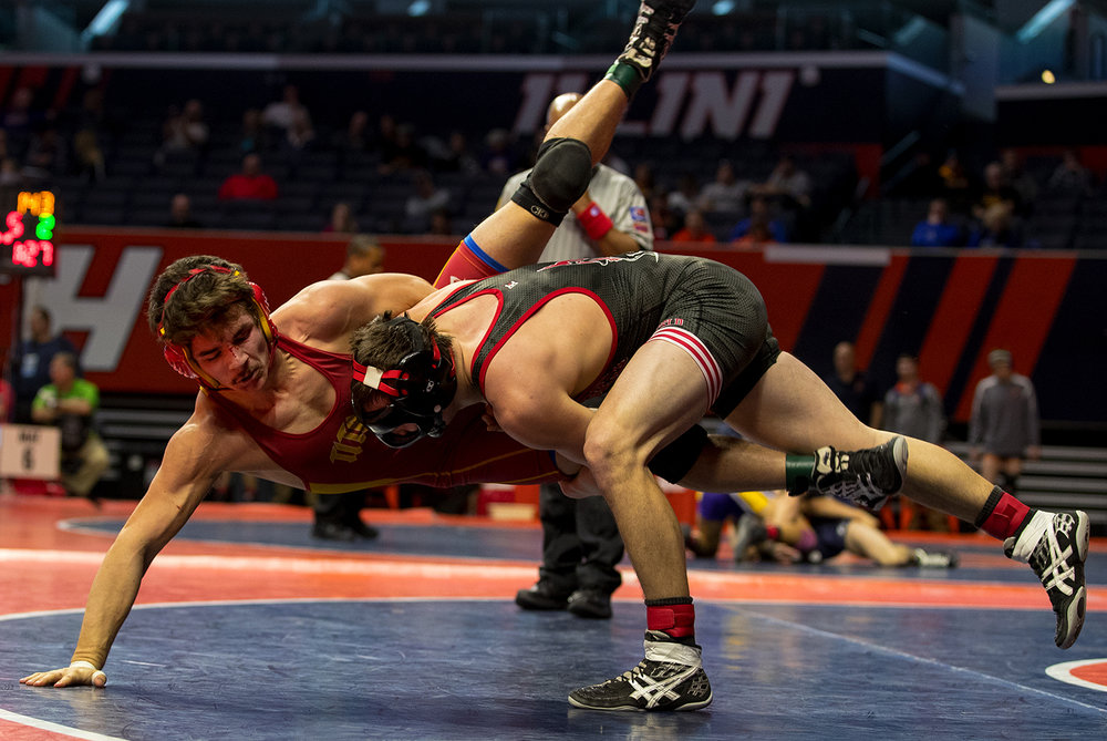 Springfield's Peyton West takes down Tinley Park's Joey Davies in the Class 2A 160 pound bout during the 2017 IHSA State Championships at the State Farm Center in Champaign, Ill., Friday, Feb. 17, 2017. West won. Ted Schurter/The State Journal-Register