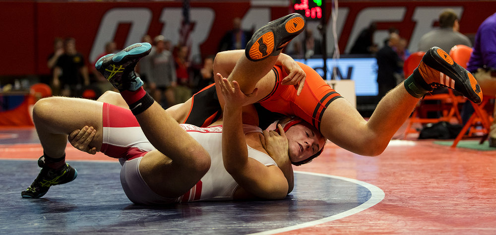 Chatham Glenwood's Hunter Crumly wrestles Washington's undefeated Jacob Warner in the Class 2A 195 pound bout during the 2017 IHSA State Championships at the State Farm Center in Champaign, Ill., Friday, Feb. 17, 2017. Crumly lost. Ted Schurter/The State Journal-Register