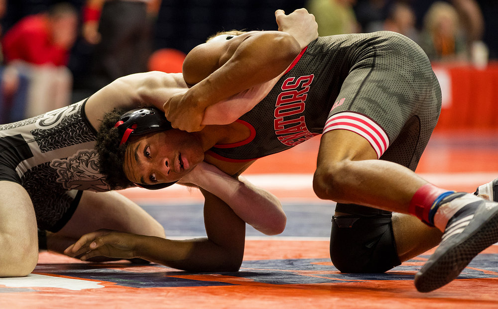 Springfield's Daniel Stewart wrestles Kaneland's Austin Kedzie in a Class 2A 120 pound wrestleback during the 2017 IHSA State Championships at the State Farm Center in Champaign, Ill., Friday, Feb. 17, 2017. Stewart lost. Ted Schurter/The State Journal-Register