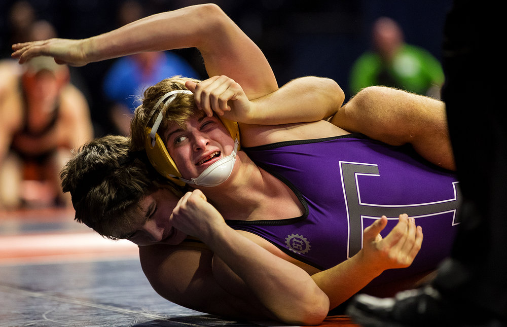 Taylorville's Heath Fleming wrestles Oak Forest's Anthony Kluk in a Class 2A 170 pound wrestleback during the 2017 IHSA State Championships at the State Farm Center in Champaign, Ill., Friday, Feb. 17, 2017. Fleming lost. Ted Schurter/The State Journal-Register