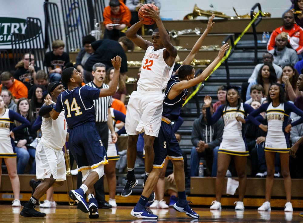 Lanphier's Karl Wright III (32) goes up for a rebound against Southeast's Isaiah Walton (10) in the first quarter at Lober Nika Gymnasium, Tuesday, Feb. 21, 2017, in Springfield, Ill. [Justin L. Fowler/The State Journal-Register]