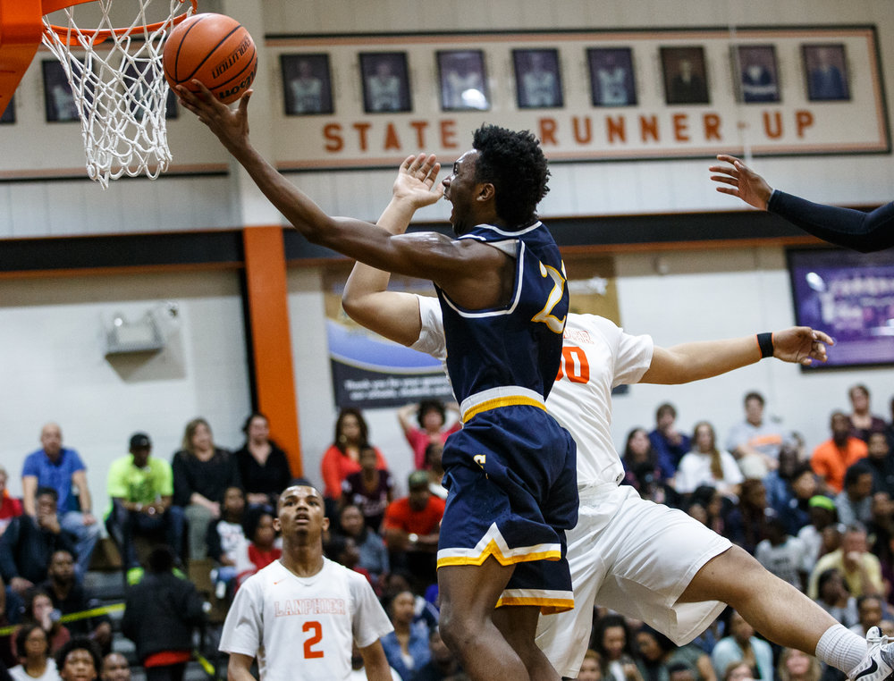 Southeast's Anthony Fairlee (21) goes up the basket against Lanphier's Will Boles (50) in the first quarter at Lober Nika Gymnasium, Tuesday, Feb. 21, 2017, in Springfield, Ill. [Justin L. Fowler/The State Journal-Register]