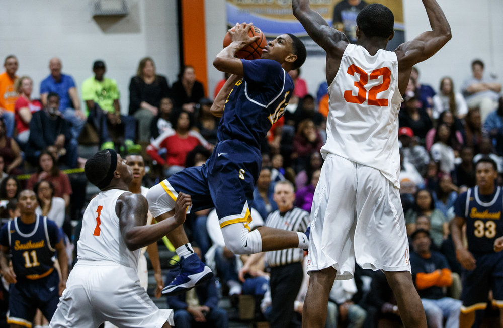 Southeast's Trevyon Williams (14) goes up to the basket against Lanphier's Yaakema Rose (1) in the second quarter at Lober Nika Gymnasium, Tuesday, Feb. 21, 2017, in Springfield, Ill. [Justin L. Fowler/The State Journal-Register]