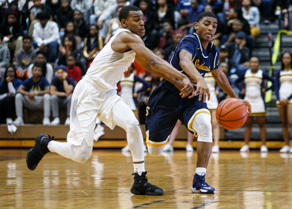 Lanphier's Aundrae Williams (3) goes after a loose ball against Southeast's Trevyon Williams (14) in the second quarter at Lober Nika Gymnasium, Tuesday, Feb. 21, 2017, in Springfield, Ill. [Justin L. Fowler/The State Journal-Register]