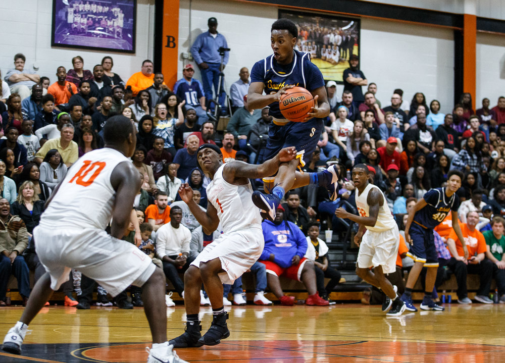 Southeast's Mark Johnson (33) leaps up to pull down a pass on a break against Lanphier's Yaakema Rose (1) in the second quarter at Lober Nika Gymnasium, Tuesday, Feb. 21, 2017, in Springfield, Ill. [Justin L. Fowler/The State Journal-Register]