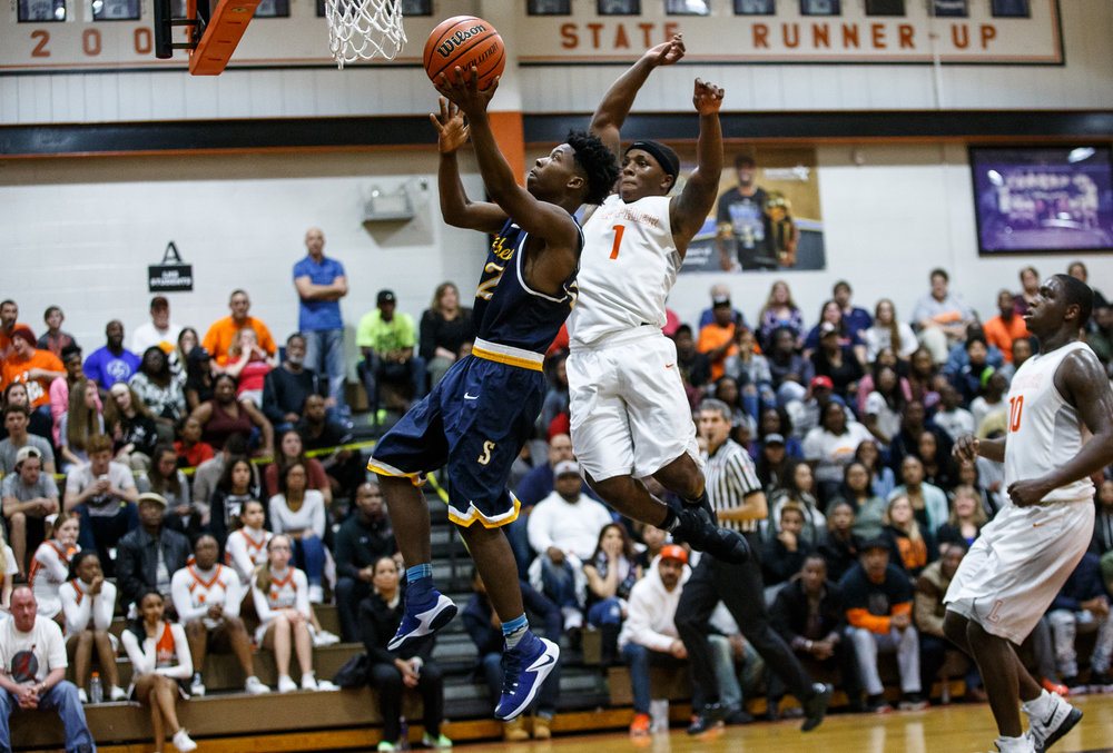 Southeast's Stepheon Sims (32) goes up for a basket against Lanphier's Yaakema Rose (1) in the second quarter at Lober Nika Gymnasium, Tuesday, Feb. 21, 2017, in Springfield, Ill. [Justin L. Fowler/The State Journal-Register]