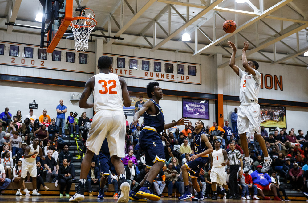 Lanphier's Cardell McGee (2) puts up a jumper over Southeast in the fourth quarter at Lober Nika Gymnasium, Tuesday, Feb. 21, 2017, in Springfield, Ill. [Justin L. Fowler/The State Journal-Register]