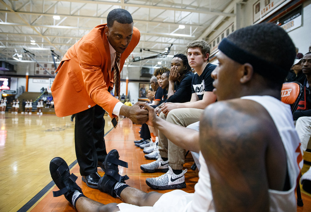 Lanphier boys basketball head coach Blake Turner comes over to talk with Lanphier's Yaakema Rose (1) after he fouled out of the game agains Southeast in the fourth quarter at Lober Nika Gymnasium, Tuesday, Feb. 21, 2017, in Springfield, Ill. [Justin L. Fowler/The State Journal-Register]