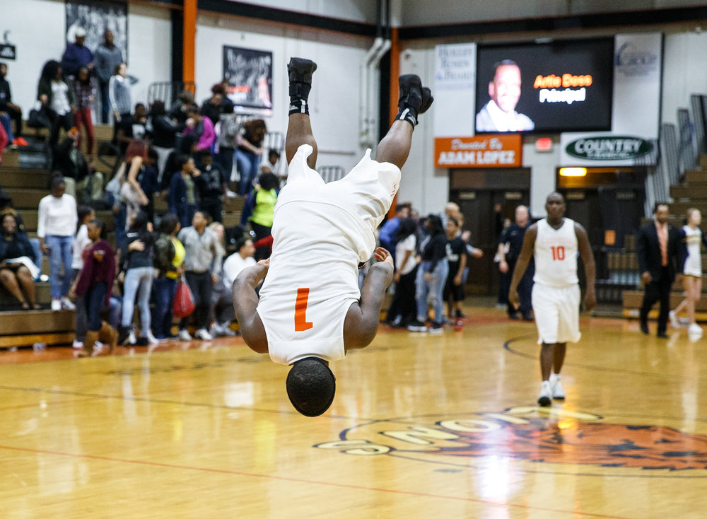 Lanphier's Yaakema Rose (1) does his backflip after the Lions defeated Southeast 65-50 at Lober Nika Gymnasium, Tuesday, Feb. 21, 2017, in Springfield, Ill. [Justin L. Fowler/The State Journal-Register]