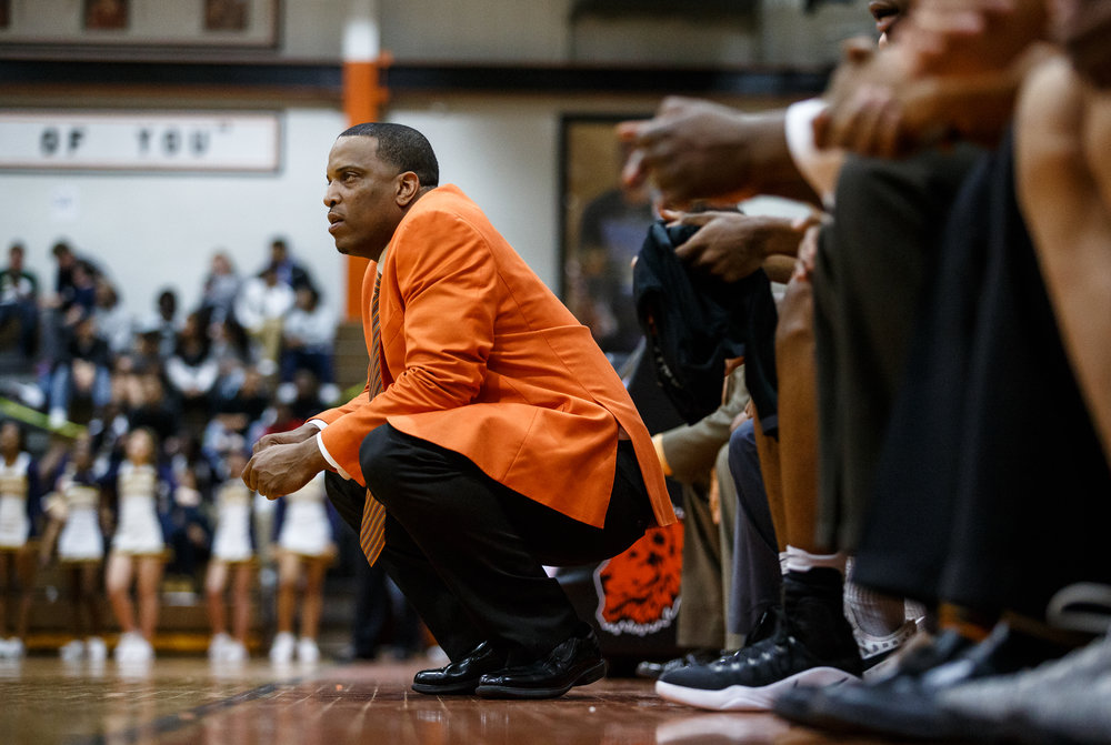 Lanphier boys basketball head coach Blake Turner watches as the Lions take on Southeast in the fourth quarter at Lober Nika Gymnasium, Tuesday, Feb. 21, 2017, in Springfield, Ill. [Justin L. Fowler/The State Journal-Register]