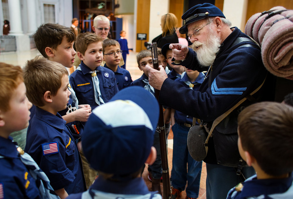 Members of Cub Scout Pack 48 from Chatham gather around Lee Shafer, a member of the 114th. Illinois Infantry Regiment Reactivated, as he describes the 1861 Springfield Armory rifled musket reproduction he carries at the Abraham Lincoln Presidential Museum Sunday, Feb. 12, 2017. The museum offered free admission in honor of Lincoln's birthday and featured activities, games, music and more to commemorate the day. [Ted Schurter/The State Journal-Register]