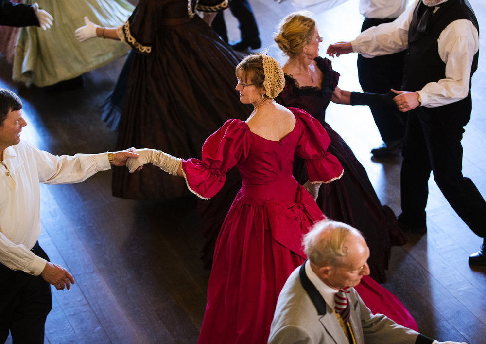 The Springfield International Folk Dancers glide across the floor to music from Abraham Lincoln's era  during a dance in honor of his birthday in the Senate chambers at the Old State Capitol Sunday, Feb. 17, 2017. The free event was open to the public and period dress was welcomed but not required. [Ted Schurter/The State Journal-Register]