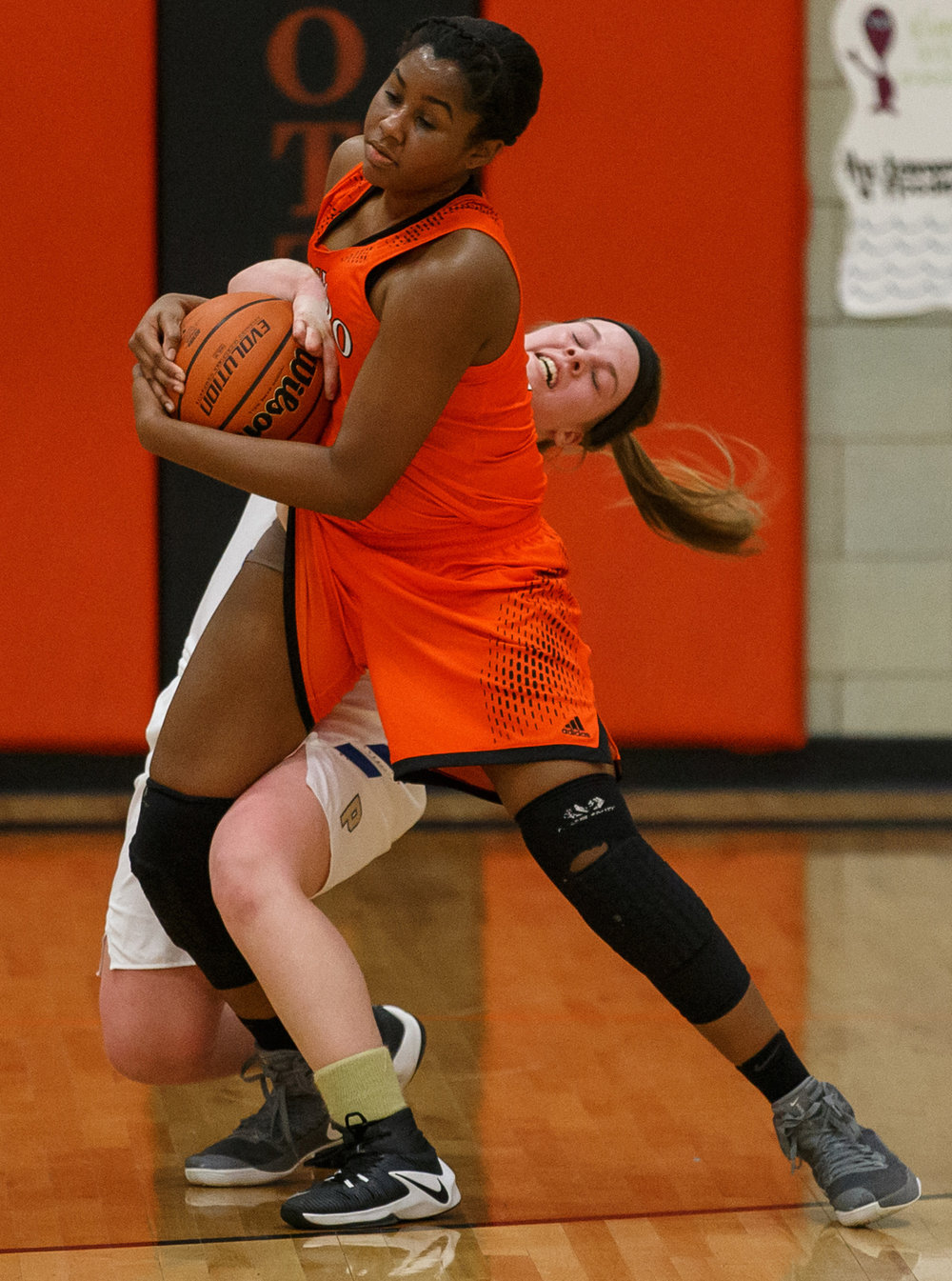 Camp Point Central's Brianna Hildebrand (33) is called for the foul as she gets tangled up with Hillsboro's Denzelle Moore (32) in the second quarter during the semifinals of the IHSA Class 2A Waverly Sectional at Waverly Elementary School, Monday, Feb. 13, 2017, in Waverly, Ill. [Justin L. Fowler/The State Journal-Register]