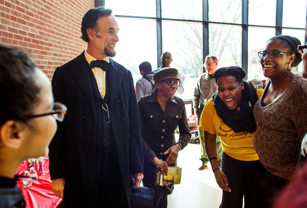Abraham Lincoln presenter Fritz Klein got a lot of laughs as he visited with students, faculty and administrators at Lincoln Land Community College Commons Monday, Feb. 13, 2017. Klein and Kathryn Harris, center, gave brief presentations before visiting with students at the event in honor of Lincoln's 208th birthday. [Ted Schurter/The State Journal-Register]