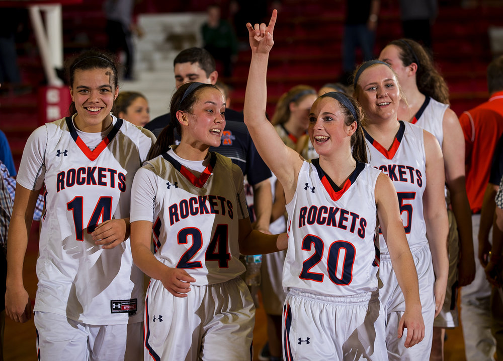 Rochester's Aubrey Magro and the Rockets celebrate after defeating Sacred Heart-Griffin 48-37 during the Class 3A Regional at The Bowl in Jacksonville February 16, 2017. [Ted Schurter/The State Journal-Register]